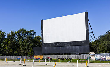 drive-in move theater screen and lot